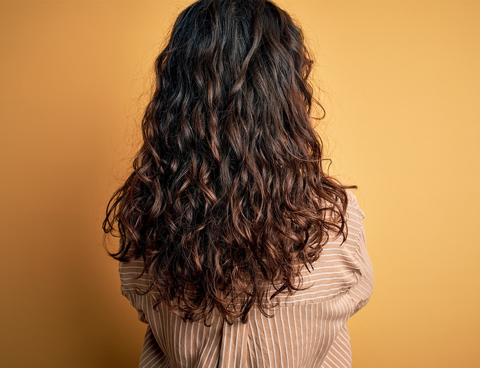 Lady with beautiful and healthy, curly hair
