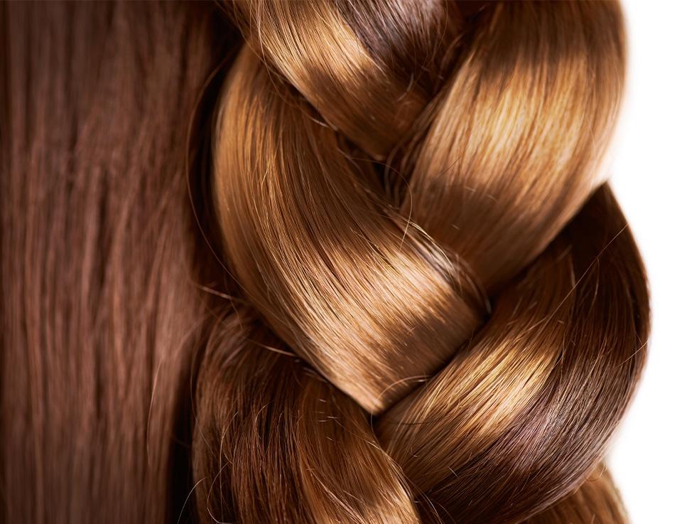 Shiny, volumized hair in braids