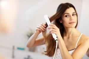lady straightening her hair