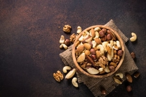 a bowl of nuts on a rustic background