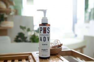 Shampoo for oily scalp and dandruff in a bathroom