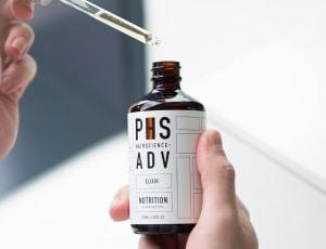 Bottle of PHS HAIRSCIENCE ADV Elixir for scalp exfoliation