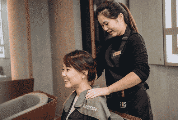 customer getting a relaxing shoulder massage at salon