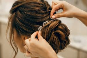 bride getting her hair ready for the wedding